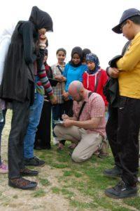 Médiateur culturel sur le site archéologique de la ville antique de Volubilis au Maroc.